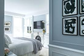 bedroom built in white and blue bedroom boasts a over a marble fireplace adorned with a