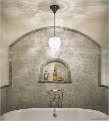 for a traditional style bath look for an opulent chandelier with crystal beads or candelabra bathroom chandelier lighting