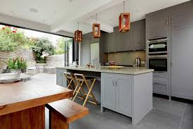 open bi fold door kitchen extension with industrial style ings