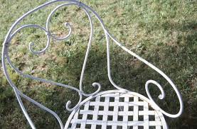 clean wrought iron patio furniture