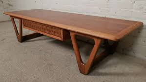 lane brand coffee table with middle basket weave drawer shaped triangle form legs oak