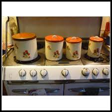 antique kitchen antique enamel kitchen canisters incredible geranium decals vintage metal kitchen canister set of four picture antique enamel popular and