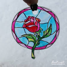 beauty and the beast enchanted rose suncatcher necklace i love beauty and the beast i love the story book introduction with the stained gl window