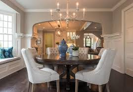round mahogany dining table with french candle chandelier