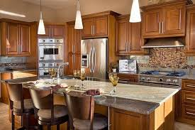 This Luxurious Kitchen Has Two Different Materials In The Backsplash. A  Metallic Stone Subway