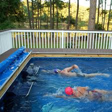 a romantic swim for two a family pool to accommodate everyone s schedules side by side swim challenges