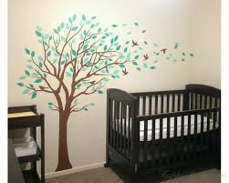 large tree wall decal with colorful leaves blowing in the wind