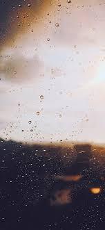 nj57-rain-window-day-sunlight-bokeh-blue