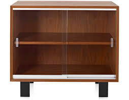brown wooden mid century cabinet with sliding glass door and shelf combined with black wooden