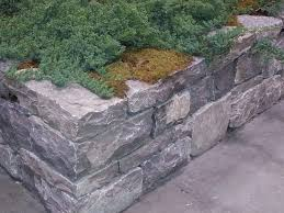 and the regularity of armour stone which is quarried stone specific sizes lends itself well to stacking and designing into retaining walls wall a55