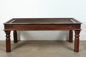 spanish style coffee table with iron inset jail work large coffee table in solid teak