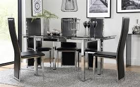 gallery space chrome black glass extending dining table with 6 celeste black chairs