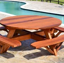 round wooden picnic table with attached