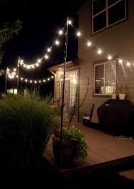 hanging patio lights. Bright July: {DIY}: Outdoor String Lights - Idea For Poles To Attach Hanging Patio T