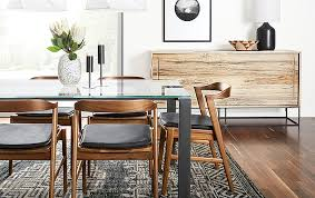 even though the steen cabinet doesn t match anything in this dining room the light to dark grain pattern of the spalted sugarberry wood picks up on the