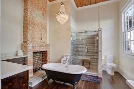 vintage french chandelier adds glam to the transitional bathroom design mlm incorporated