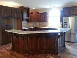 beautiful new kitchen using osborne modified bar corbels island columns wood diy with cooktop and prep sink kitchenaid mixer under cabinet storage home