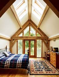 Rooflights in the vaulted ceiling and a glazed gable end ensure this  bedroom gets lots of