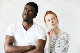 Close up shot of black male and white female posing isolated.
