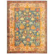 beautiful blue background antique turkish oushak rug for