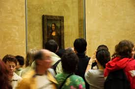 researcher says mona lisa be covering hidden painting time  ors to the musee du louvre lining up see leonardo da vinci s la joconde the