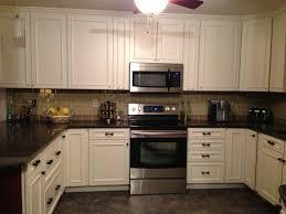 khaki and champagne glass subway tile kitchen backsplash