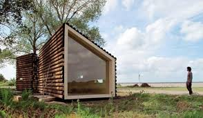 micro flake. Dwell meets Abe Lincoln in this modern version of a log cabin  designed by OLGGA Architects in France. The house is clad in unmilled  timbers ...