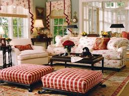 living room white pattern sofa with cushions and square red striped ottoman also rectangular
