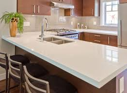 White Kitchen Countertops With Wooden Kitchen Cabinet And Black Pad Mini  Bar Chairs: Full ...