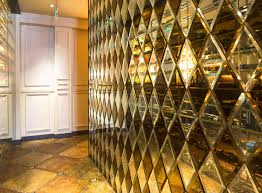 bronze and clear mirror beveled tile wall