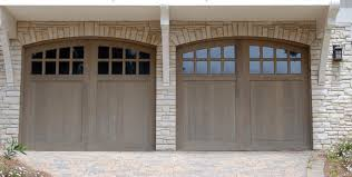 white wood garage door. Two Car Garage Features Natural Wood Arched Doors With Upper Panel Windows, Nestled In Light White Door