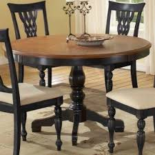 outdoor wood dining table set. round wood dining table with a black-finished pedestal base and outdoor set s