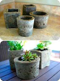 homemade pots made from cement. A good way to use up the bags of cement