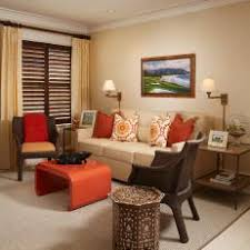 Tropical Beige Living Room With Burnt Orange Accents