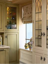 elegant kitchen photo in san francisco with glass front cabinets