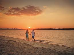 Image result for couple on the beach sunset