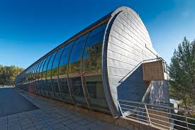 architecture building design. The Advanced Design Centre Building Has A Length Of 50 Metres And Width 20 Is Shaped Like Cylinder. Surrounded By Pine Trees, Concrete Architecture