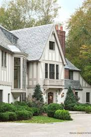 exterior house painting application. love the soft grey and white over brown cream usually seem on tudor houses exterior house painting application t