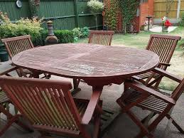 billy oh teak extendable table and six collapsible chairs warrington