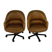 pair of brown leather office chairs chairs