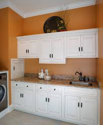 laundry room makeovers charming small. Laundry Room Makeover With Brown Faucet And Basin Uses Granite Tile Makeovers Charming Small E