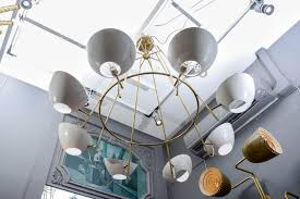 italian round brass chandelier with white cups for