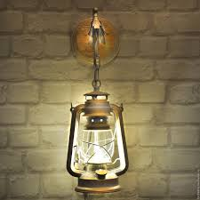 sconce oil lamp with an led bulb that mimics the light of a candle
