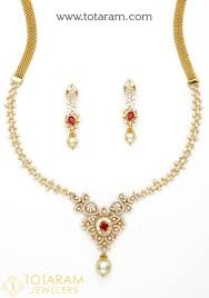18k gold diamond necklace drop earrings set with color stones south sea pearls