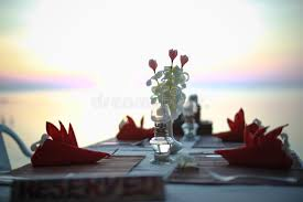 dinner table background. Download Table In The Restaurant On Sea Background Decorated Of Flowers. Is Ready Dinner