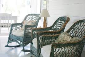 looking out toward the nearby barnountains vintage wicker rocking chairs grace the porch