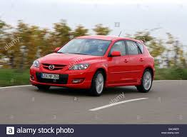 Mazda 3 MPS, model year 2006-, red, driving, diagonal from the ...