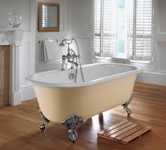 tropical bathroom design with ovel white porcelain stand alone