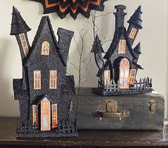 Light Up Haunted Houses #pbkids. Cardboard, a little paper mache and spray  paint