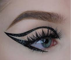 try darkening your upper eyelids with shimmering black eyeshadow the inclusion of glitter helps to offer a slightly feel while luxurious